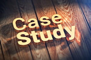"The words ""Case Study"" is lined with gold letters on wooden planks. 3D illustration image"